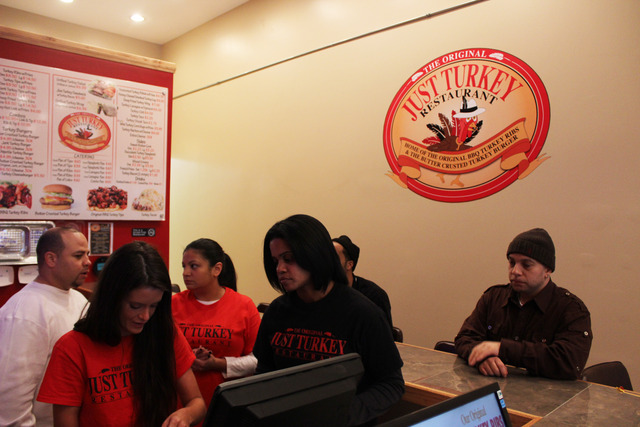 <p>Ginger Maddox, second from right, teaches a new employee how to work the cash register at Just Turkey on Bryn Mawr Avenue.</p>
