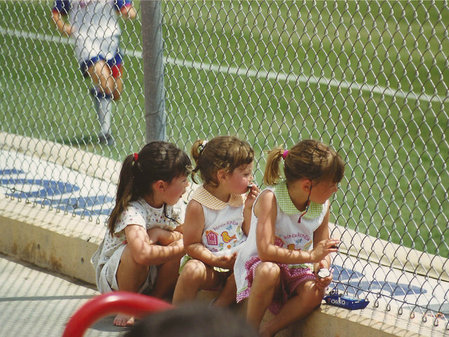 <p>From left, Gena, Cate and Ali Lenti watch a DePaul softball game as children. Gena and Ali play for the DePaul softball team and their dad, coach Eugene Lenti, while Cate said she&#39;ll be attending the school after she graduates from St. Ignatius College Prep.</p>