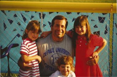 DePaul softball coach Eugene Lenti poses with his daughters (from left to right) Gena, Cate and Ali. Gena and Ali now play for Lenti and the Blue Demons. Cate won't play at DePaul, but she said she'll definitely attend school there.