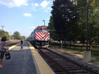 A Metra Train prepares to stop at the Edison Station.