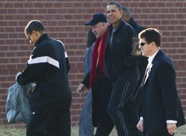 President Barack Obama walks with his friend Eric Whitaker as they arrive to play basketball at a gym at Fort McNair in Washington, D.C., Feb. 6, 2011.