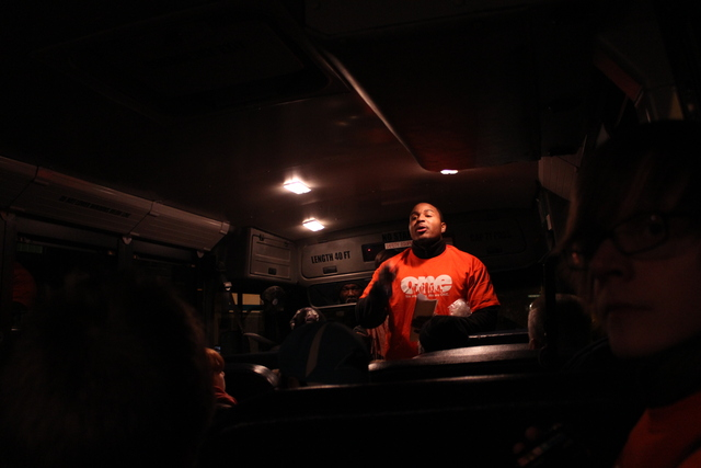 <p>A members of Organization of the Northeast sang songs of solidarity on one of two buses headed to the Gold Coast.</p>