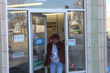 Lisa Keys leaves her favorite currency exchange at 531 E. 79th St. and prefers it over a bank.