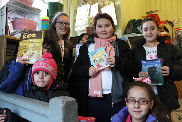 <p>Rachel Perveiler, a teacher at Finkl Elementary, started a small library on her back porch for her neighborhood kids in Little Village. (From left to right: Joaquin, Carla, Rachel, Jos&eacute;, Leslie, Jennifer, Jaylene)</p>