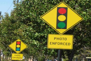 A pair of signs warn drivers of red-light camera enforcement along Cicero Avenue.