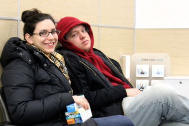 Renee Grischeau, 25, accompanies boyfriend Luke Rzeszutko, 25, to the Walgreens Take Care clinic this week after he suffered a fever and cough and other flu-like symptoms.