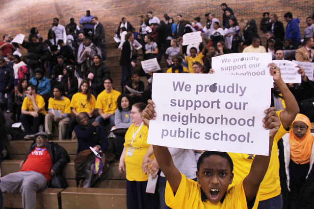 <p>A student from Gale Elementary in Rogers Park holds a sign in support of his school.</p>