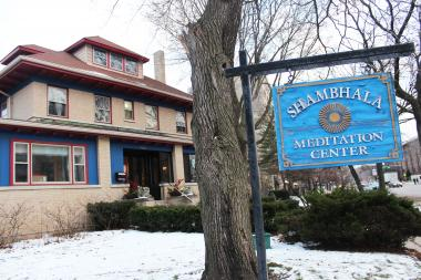 The Shambhala Meditation Center plans to move to a new location this summer before the building they've owned since 1995 would be torn down under a proposal to erect a four-story parking garage.