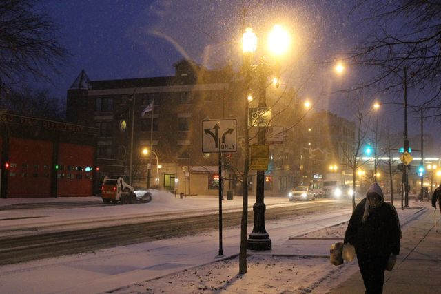 <p>Snow falls early Friday morning on West Wilson Avenue in Uptown.</p>