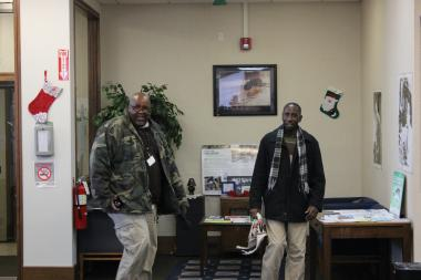 Clarence Hogan, manager of the Family Network Center at the Teamwork Englewood Technology Center (left), and Limarcus Saffold, employment specialist for the center, arrive to the office Wednesday morning.