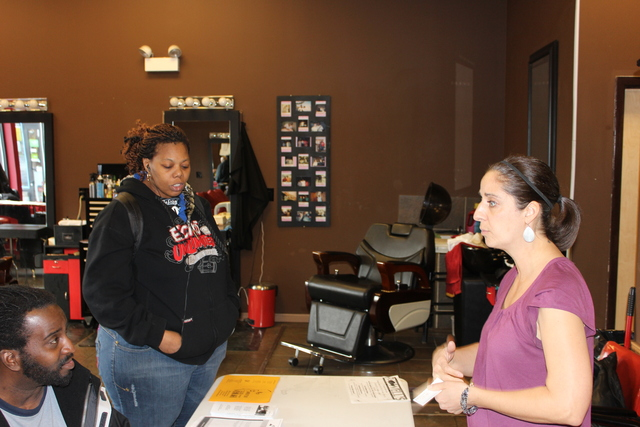 (Middle) Kristin waltz, a case manager for Inspirational Corporation, a Chicago non profit, answers questions from career seekers at a South Side career expo Monday, Jan. 28, 2013.