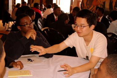 Vincent Yu, a University of Chicago undergrad and financial mentor, leads a session with high school students at the Moneythink Young Entrepreneur's Conference last year.