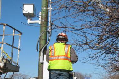 A technician installs an American Traffic Solutions speed camera in the 6500 block of north Western Ave. for pilot testing in November 2012.