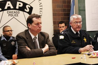 "Ald. Joe Moore (l.) and Cmdr. James Roussell share details about a recent drug bust near the Morse Avenue ""L"" station."