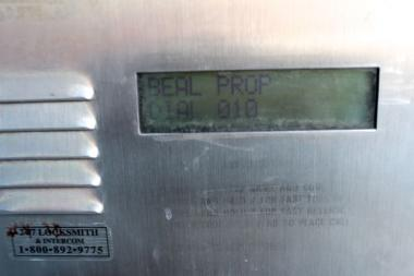 A call box at 2320 N. Damen Ave. in Bucktown is the only evidence of a former name that a realty company is trying to shed: Beal Properties.