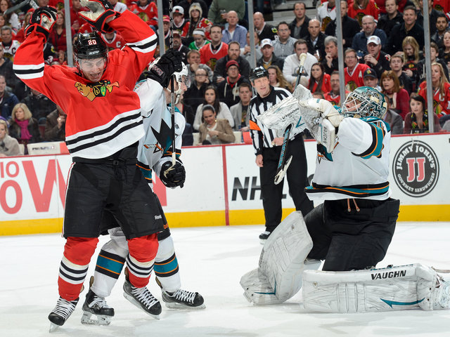 <p>Brandon Saad celebrates after scoring the game-winning tally against San Jose goalie Antti Niemi.</p>