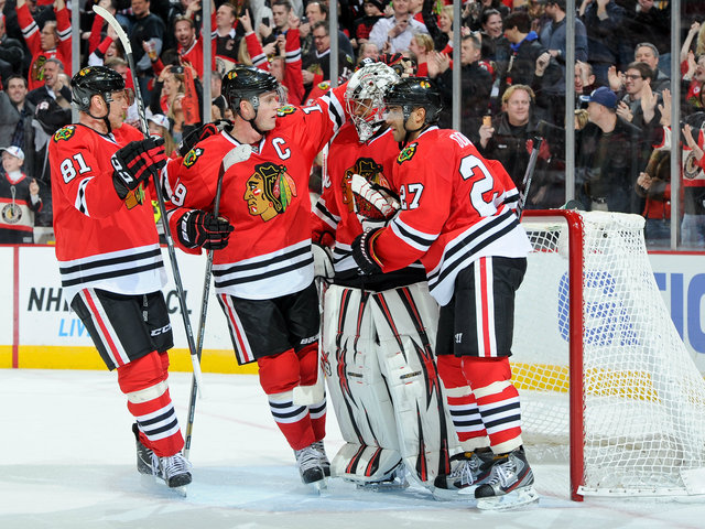 <p>From left, Blackhawks Marian Hossa, Jonathan Toews, Ray Emery and Johnny Oduya celebrate a 2-1 victory over the San Jose Sharks on Friday.</p>