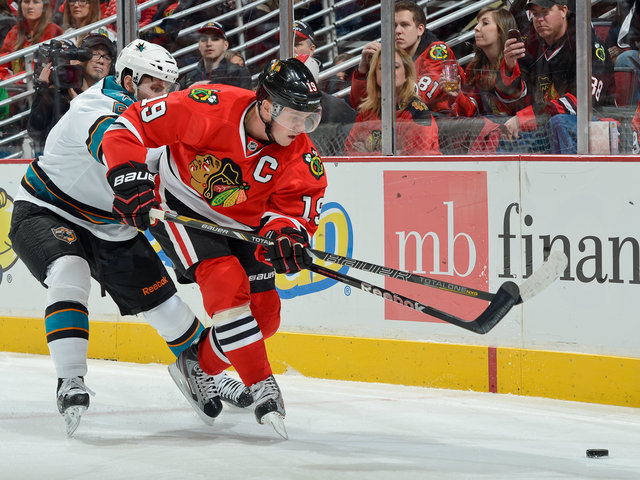 <p>Blackhawks captain Jonathan Toews (right) battles against San Jose&#39;s Jason Demers during Chicago&#39;s 2-1 victory on Friday.</p>