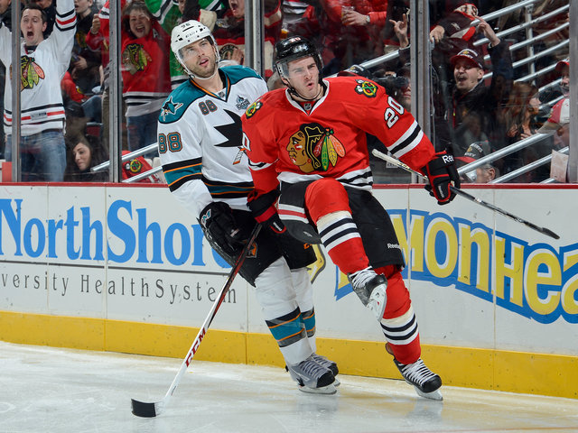 <p>Brandon Saad (right) reacts after scoring the winning goal against Brent Burns (left) and San Jose on Friday.</p>
