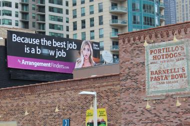The adult billboard hovers near the intersection of Clark and Ontario.