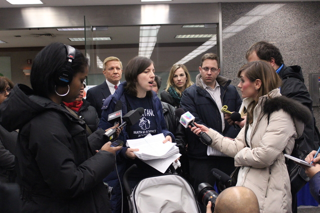 <p>Brentano Local School Council Member Kate Kindleberger talks to media in the lobby of CPS headquarters, Wednesday, Feb. 6, 2013.</p>