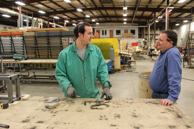 <p>Dave Harkness, a carpenter at the Goodman Theatre Scene Shop, chats with production manager Scott Conn.</p>