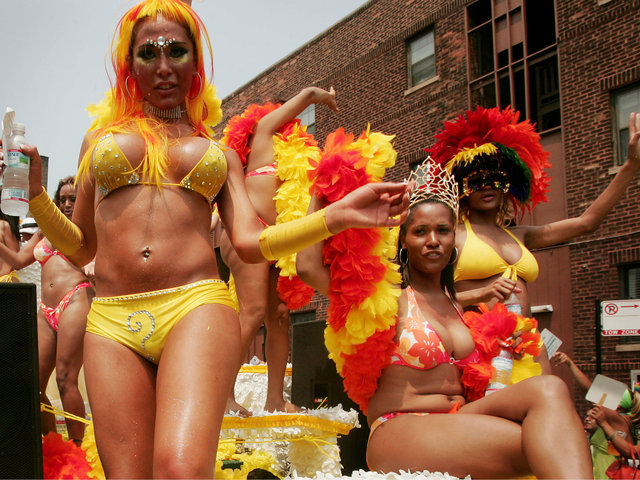 <p>Parade participants dance on a float as it travels through the city&#39;s gay district during the 36th annual Gay and Lesbian Pride Parade June 26, 2005.</p>