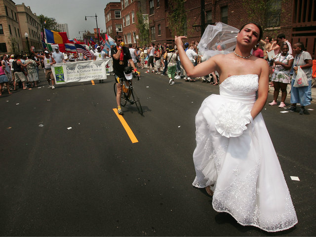 <p>A gay marriage advocate marches through the city&#39;s gay district during the 36th annual Gay and Lesbian Pride Parade June 26, 2005.</p>