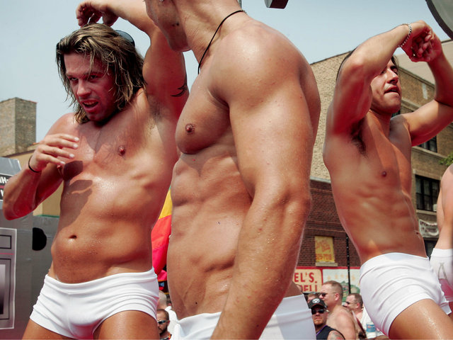 <p>Parade participants dance on a float as it travels through the city&#39;s gay district during the 36th annual Gay and Lesbian Pride Parade on June 26, 2005.</p>