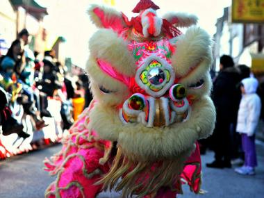 The annual Chinese New Year parade in Chinatown draws marching bands and colorfully costumed performers.