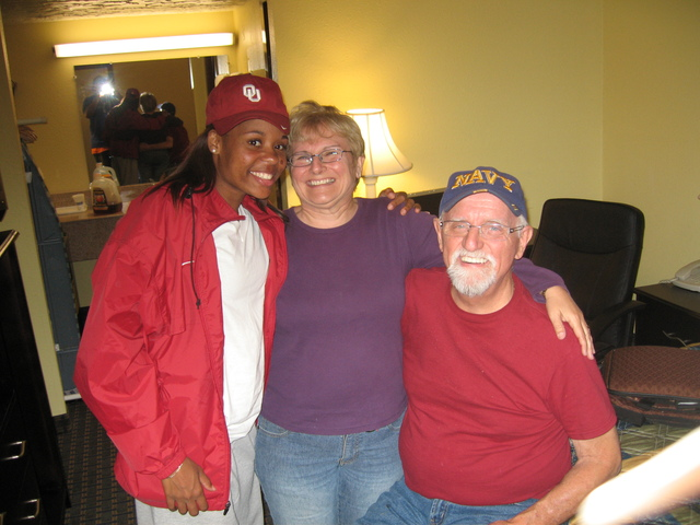 <p>Dominique Jacobs (left) poses with Margaret Klaus and her husband, Bob, while Jacobs was a student-athlete at the University of Oklahoma.</p>