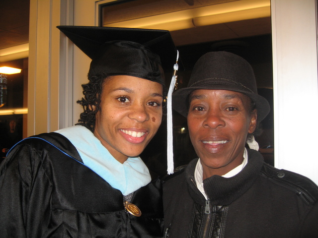 <p>Dominique Jacobs (left) poses with her mother, Lula Jacobs, after earning her master&#39;s degree in education at North Park University.</p>