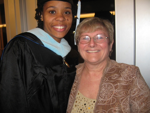 <p>Dominique Jacobs (left) poses with Margaret Klaus after earning her master&#39;s degree in education at North Park University.</p>
