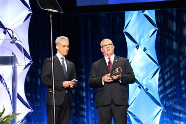 Mayor Rahm Emanuel and Choose Chicago's President and CEO Don Welsh present the 2013 Tourism Ambassador Award to Holly Agra, president of Chicago's First Lady Cruises.