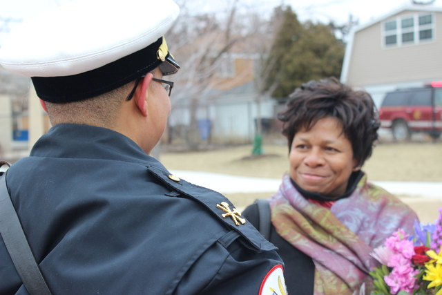 <p>Diane Patmon, wife of fallen first responder Walter Patmon, is embraced by an officer after she was honored as a Grand Marshal of the 2013 South Side Irish Parade.</p>