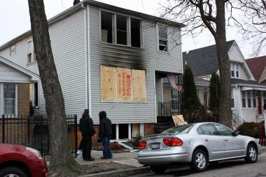 Crews boarded up a home on the 3300 block of North Kedvale Avenue where Patricia Burns perished in a fire Thursday.