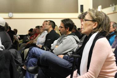 Residents listen to a proposal for a 20-story residential building in the West Loop. After negative response from attendees at Tuesday's meeting, Ald. Walter Burnett (27th) said he would not bring the proposal before city hall.