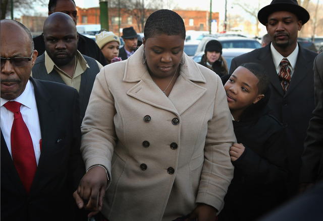 <p>Cleopatra Pendleton arrives with her son Nathaniel for the wake of her 15-year-old daughter Hadiya Pendleton at the Calahan Funeral Home.</p>