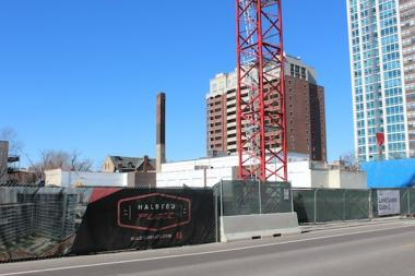 Halsted Flats, a 15-story development project with retail and condos, will be ready for rental in fall 2013.