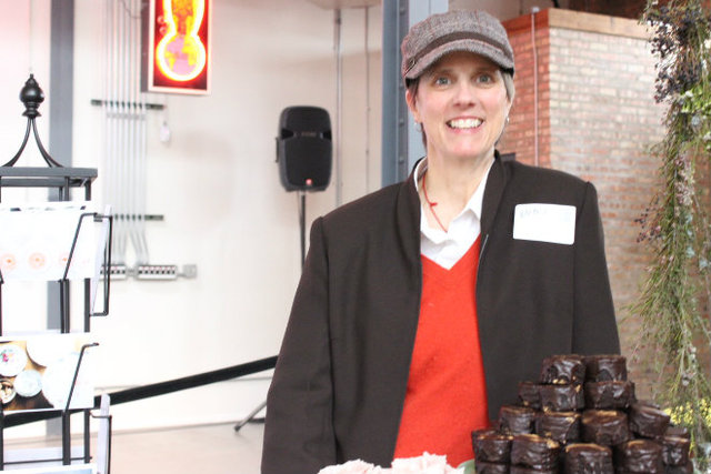 <p>Sally Kenyon of Uptown Brownies displays her pastries at Indie Wed.</p>