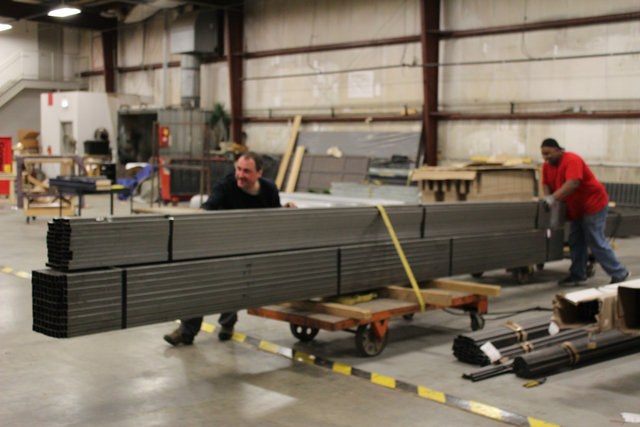 <p>Workers at the Goodman Theatre Scene Shop move a pallet full of steel bars toward the shop&#39;s metalworking section.</p>