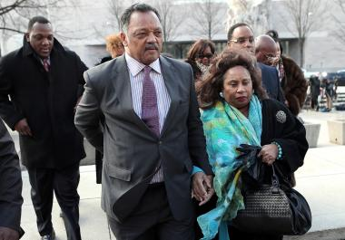 The Rev. Jesse Jackson (l.) and his wife Jacqueline arrive Wednesday for their son Jesse Jackson Jr.'s guilty plea at a court hearing in Washington, D.C.