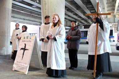 "Members of Lincoln Park's Church of Our Saviour Episcopal Church dispense ashes to commuters outside the Fullerton ""L"" stop Wednesday morning."