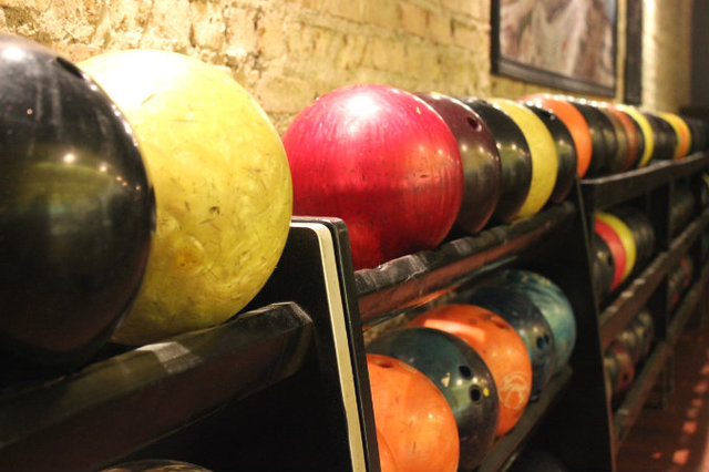 <p>Bowling balls ready for action at the remodeled Lincoln Square Lanes.</p>