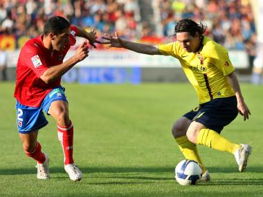 Lionel Messi (right) with Juan Ramon Cabrero of Numancia during a match between Numancia and Barcelona in 2008 in Spain