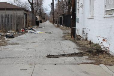 The man's vehicle struck a wall before he exited in an attempt to run after shots were fired late Monday morning on the 700 block of South Washtenaw Avenue in East Garfield Park.