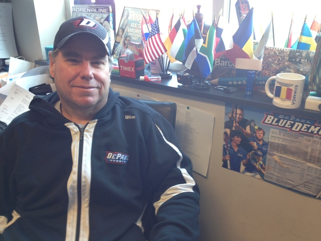 <p>DePaul women&#39;s tennis coach Mark Ardizzone poses in his office. Flags from the numerous European countries Ardizzone has visited on recruiting trips are in the background.</p>