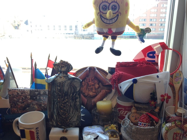 <p>Flags and other memorabilia from the numerous European countries Mark Ardizzone has visited on recruiting trips are in the background.</p>
