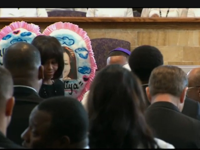<p>First lady Michelle Obama comforts Cleopatra Cowley-Pendleton, mother of Hadiya Pendleton, at the girl&#39;s funeral at Greater Harvest Baptist Church.</p>