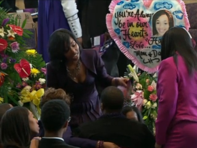<p>A family friend comforts Cleopatra Pendleton, mother of Hadiya Pendleton, at the girl&#39;s funeral.</p>